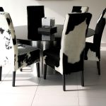 cowhide chairs for dining room black round glass dining table white ceramic tiles floors