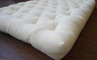 crib all wool organic matresses in white soft fabric material