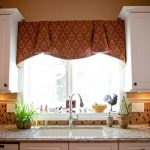 curtain for window kitchen over the sink granite kitchen countertop with sink and faucet some decorative vases roll tissue a small decorative pot with green plant white floating cabinets