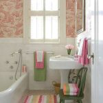 cute bathroom ideas with colorful mat and bathtub plus green wooden chairs and wash basin and rectangle mirror and pink girly wallpaper
