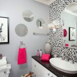 cute bathroom ideas with vanity and sink plus cute wall accent and curved mirror and girly picture plus round mirrors