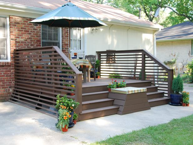 Superb Dark Finished Wood Horizontal Deck With Wood Outdoor Furniture And Big Shade