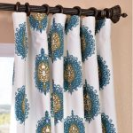 dark metal half curtain rod with rod rings white base curtain with blue and brown artistic patterns