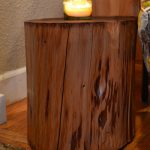 dark stained log wood stump side table a decorative glass for standing the candle