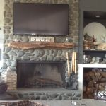 driftwood mantle fireplace as TV stand  a fireplace build with  river stones wall construction mount wall shelves for decorative items and log supplies