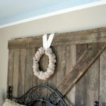 duct tape crown molds idea  a wood barn door decoration with white wreath