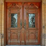 ethnic front door design from solid wood material double glass and wood panels with beautiful ornaments
