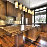 exotic large kitchen design with industrial cabinetry idea and stunning island countertop in inexpensive style beneath candle pendants above bamboo laminated floor