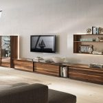 extra long media cabinet made from wood floating TV installation a floating shelving unit for organizing the decorative items books and picture frames