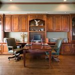 face to face working desk for two persons comfy leather movable chairs two units of laptop big wood buffet
