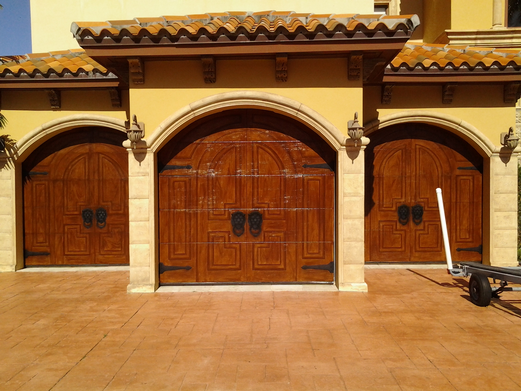 Garage Doors Designs moving porch hydraulic door Fancinating Garage Door Costco With Solid Hard Wood Material Plus Good Door Panel Combined With Tile
