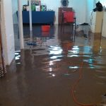 flooding basement with table and chair plust chest of drawers