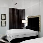 frameless wall mirror for bedroom a cozy and big bed furniture in black theme black and white stripes on carpet some picture frames