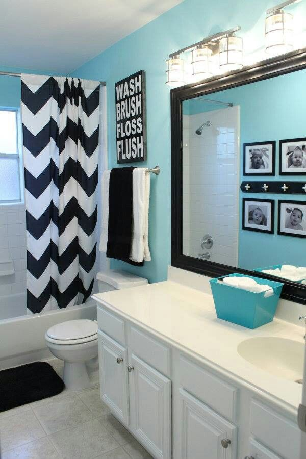 fresh blue cute bathroom ideas with bathtub covered with curtain and toilet  and white vanity units