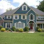 fresh exterior painting for home with blue color schemes wall and grey roof with green garden