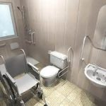 gorgeous grey handicap accessible bathroom design with wheel chair aside modern toilet seat with simple vanity design beneath casual wall mirror