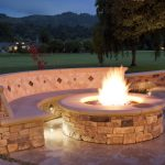 great-coolest-wonderful-nice-warm-patio-with-fire-pit-with-ignited-patio-fire-pit-made-of-brick-with-round-shape-and-small-seat-design-made-of-rocks