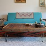 hairpin coffee table with old and antique look wood surface a beautiful turquoise sofa with wood side-table  a minimalist stand light fixture white fury carpet beautiful carpet with patterns
