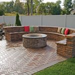 Half Circled Permanent Seating Made From Bricks With Beautiful Pillows And Round Fire Pit That Is Functional As Cooking Source As Well