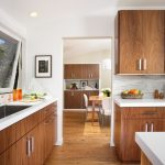 hardwood kitchen cabinets with stainless steel handles a large sink with single faucet hardwood flooring for kitchen area