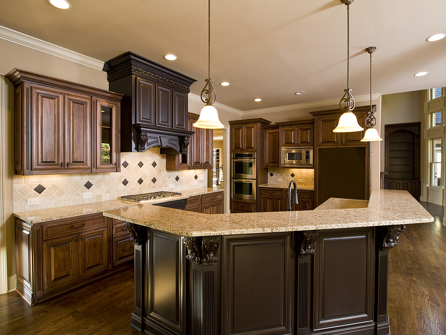 Impressive Kitchen Remodeling With Marble Countertop On Dark Cabinets  Curved Island Combined With Wooden Floor And