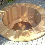 in ground wood Japanese tub with bench seat feature