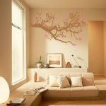 interior exterior painting in living room with cream paint color scheme with wall stickers and sofa plus picture and clock plus pot vase