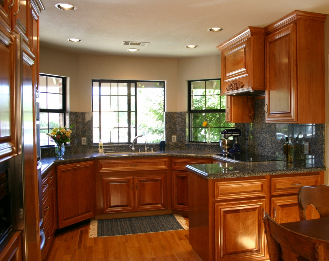 Kitchen Remodeling With Brown Modern Wood Cabinets Plus Marble Countertops  And Backsplashes And Sink Combined With