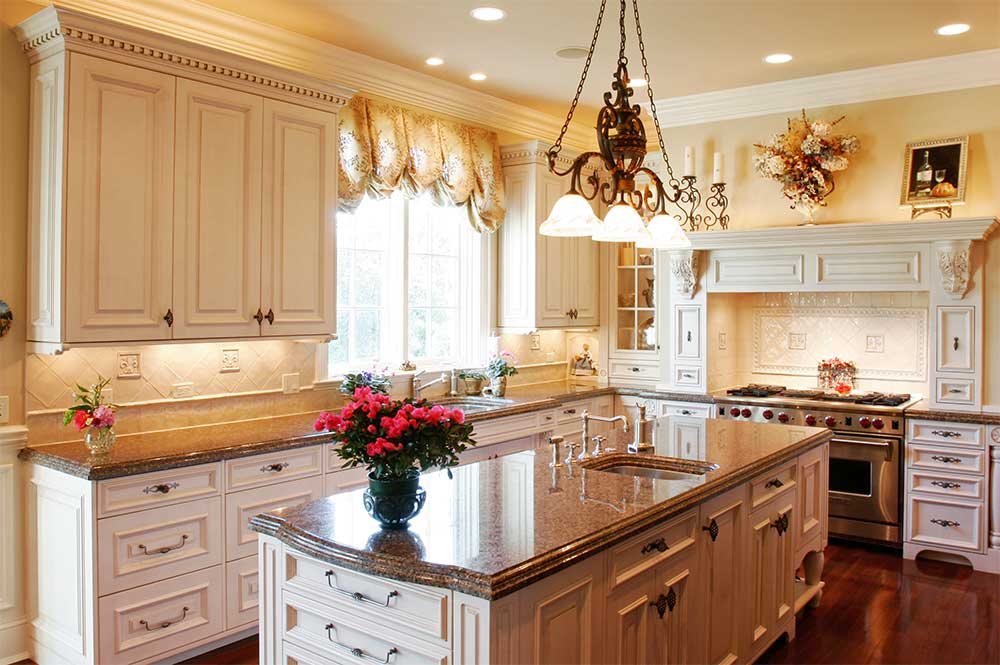 kitchen remodelling contractors launderdale company with classic white wooden cabinets and granite countertop plus kitchen island with sink and flowers and chandeliers