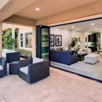 la cantina folded glass door with black frame a set of  outdoor furniture a set of luxurious open space for living room and dining room
