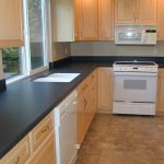 laminate finished countertop in black a pure white double sinks white finished kitchen electric appliances wood cabinets system