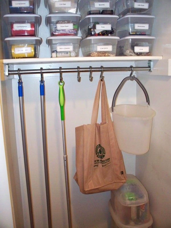 Wonderful Large Broom Closet Design With Stainless Pole Hooks And Several Plastic  Storage With Bag And Vacuum