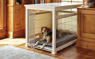 large metal wire dog crate in white with comfortable bedding