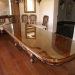 large solid wood desk table tops with glass on top plus beautiful ornament egdes and brown furnishing