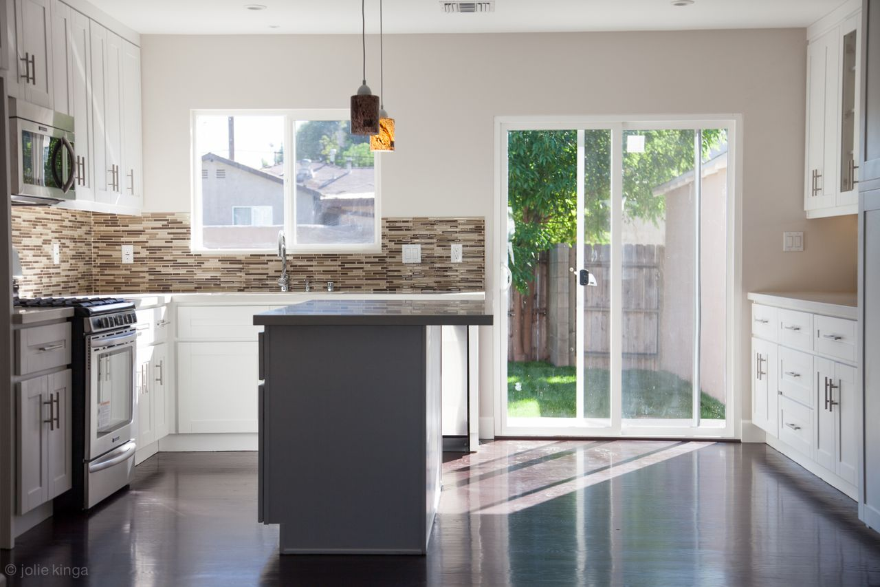 Los Angeles Kitchen Remodelling Contractors With Grey And White Cabinets  Plus Backsplashes And Pendant Lamps And