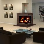 Luxurious And Modern Two Sided Fireplace Design With Brown Mantel Beneath Bold Concrete Wall Aside Recessed Cabinet Before Modern Black Sofa With Navy Blue Coffee Table