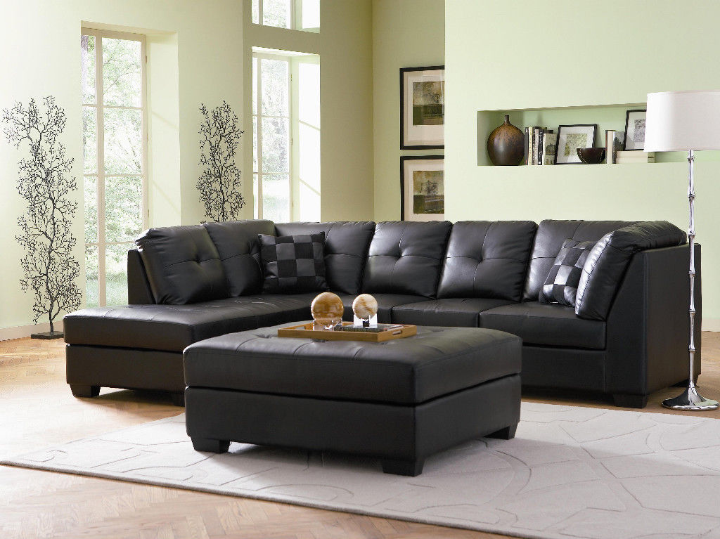 luxurious black leather sectional sofa with black pillows wall mount