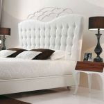luxurious crown shaped freestanding headboard design with white side table and brown table lamps upon white area rug