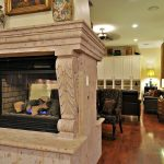 luxurious framed two sided wood burned fireplace some luxurious and expensive furniture dark finished wood floors
