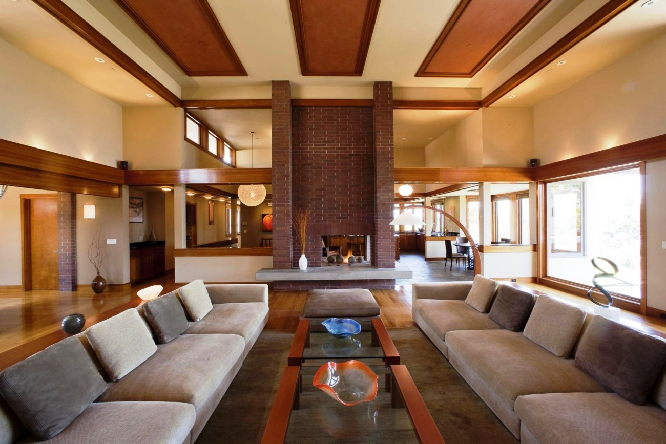 Luxurious Living Room Designed By Chicago Interior Design Firms With Long Fabric Brown Sofas And Glass