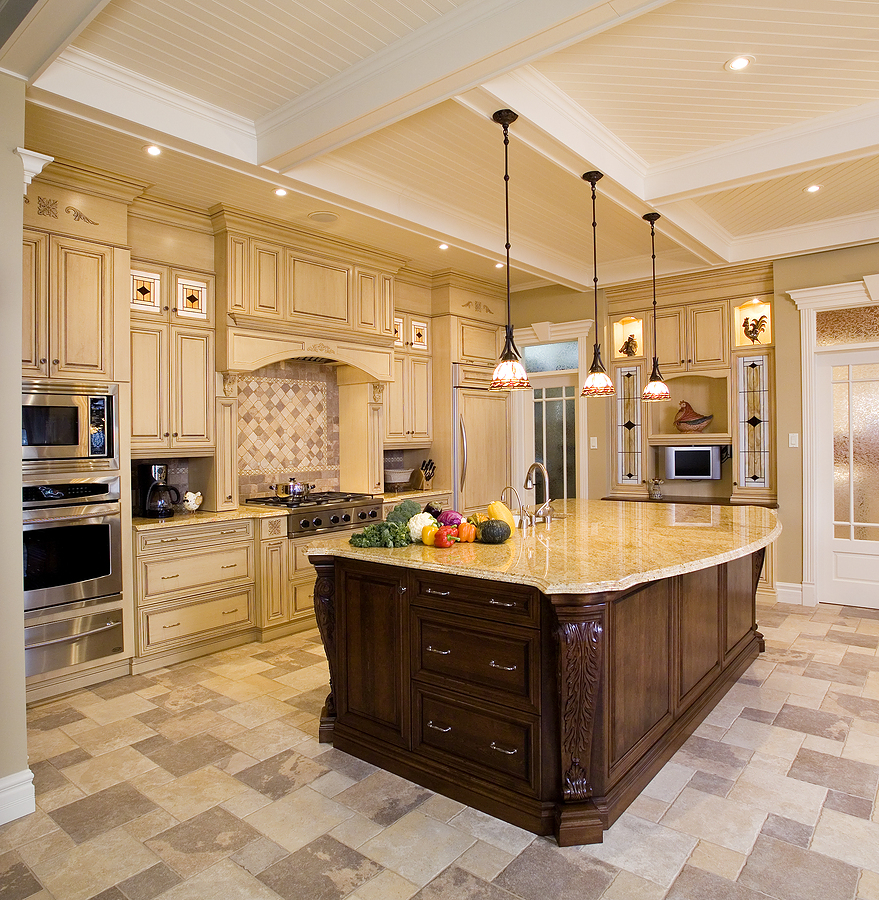 luxury kitchen remodeling with wooden cabinets and dark wooden island plus marble countertops plus sink and bautiful pendant lamps and kitchen appliances and tile floor plus backsplashes