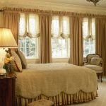 luxury window treatments nyc with beautiful light brown curtains and shades in bedroom combined with king bed and armchairs plus night stand with table lamp