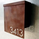 metal mail box with number initial