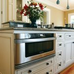 microwave drawer under kitchen countertop a vase with flowers