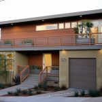 mid century modern garage doors for single car with wood material combined with path ways and beautiful home design