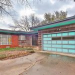 mid century modern garage doors in aqua scheme with wood material and unique wall plus concrete floor and brick wall home