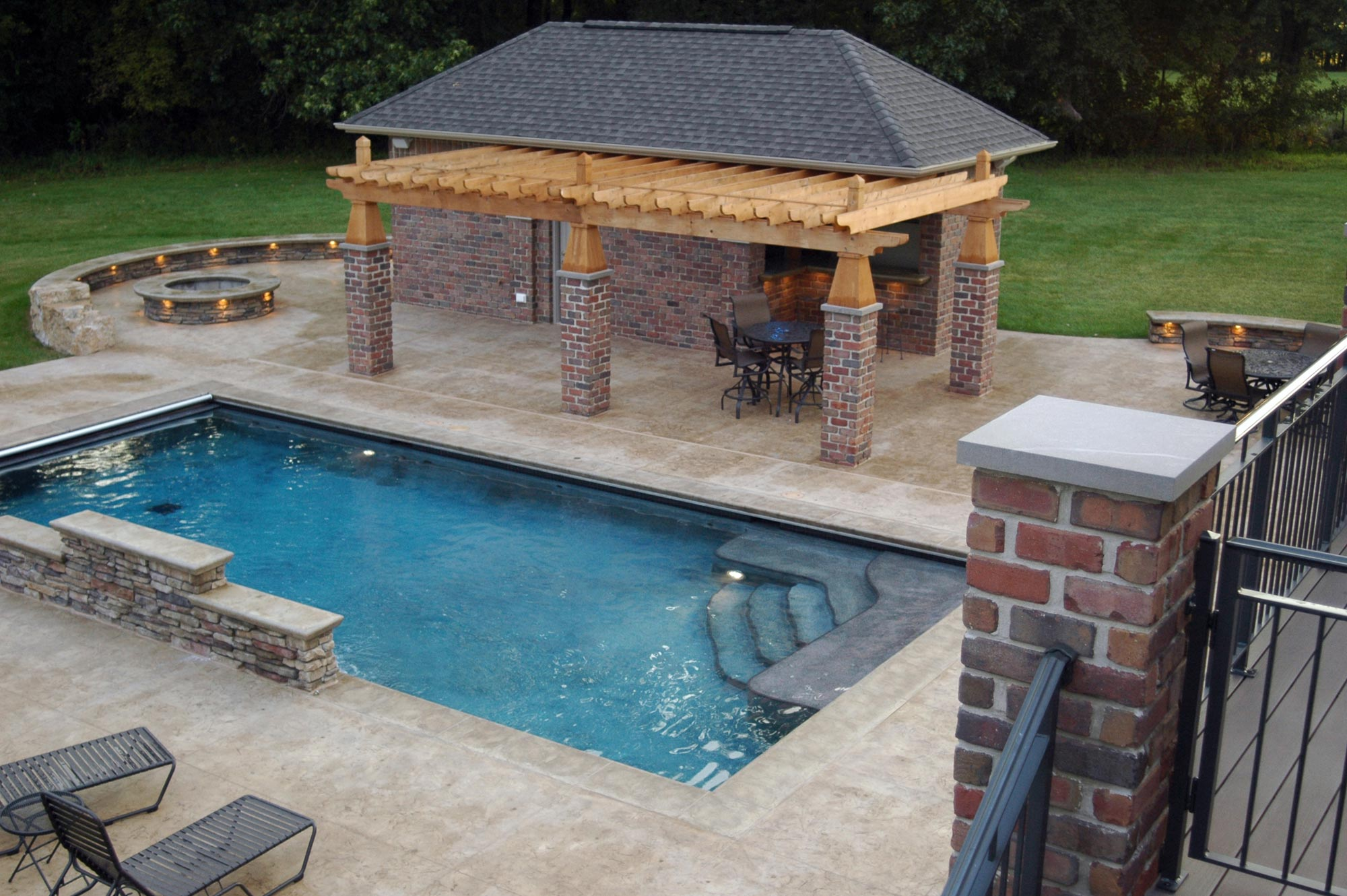 mid west rectangle pool designs with natural floor and pool lounge chairs plus outdoor living area - Rectangle Pool