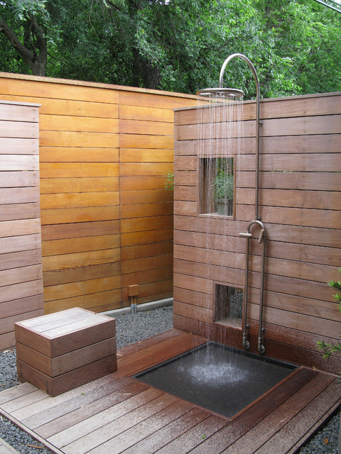 minimalist outdoor shower space with horizontal wood planks wall system stainless steel free standing shower head