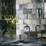 mirror tiles for backsplash a square sink and simple stainless steel faucet black marble kitchen countertop a glass wine