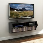 modern and functional floating media center with book shelf in most bottom and open shelves for DVD player in upper a TV set